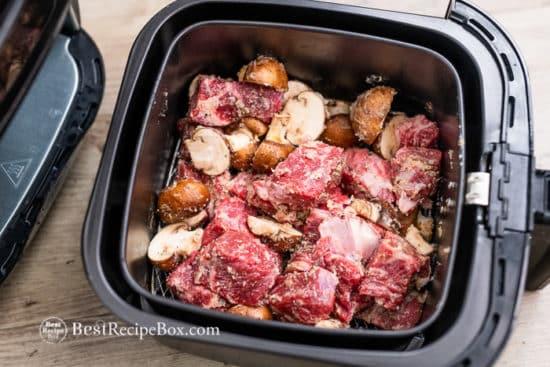 steak bites and mushrooms in air fryer basket
