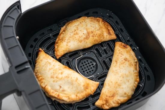 Air fried apple hand pie in air fryer basket