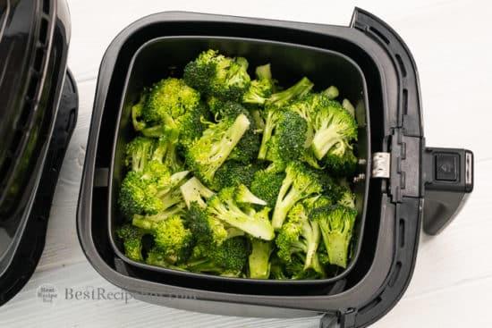 Transfer seasoned broccoli to air fryer basket