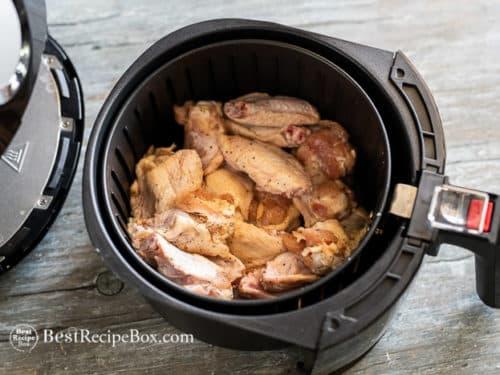 Uncooked wings in air fryer basket