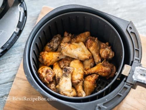 cooked wings in air fryer basket