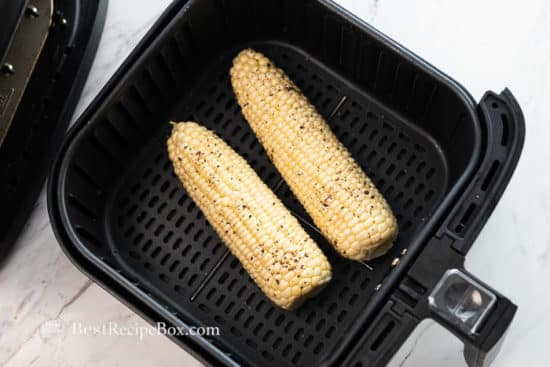 Season corn with salt, pepper and butter