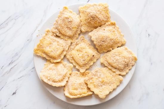 Ravioli coated in parmesan and bread crumbs