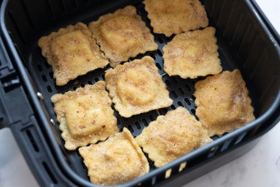 Ravioli in a single layer in air fryer basket