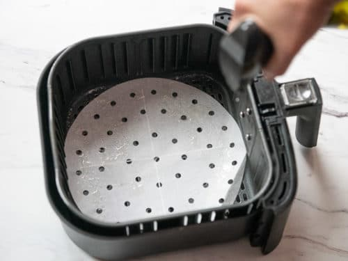 Spraying Air Fryer Basket with Oil Spray