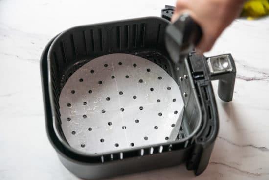 Spraying Air Fryer Basket with Oil Spray