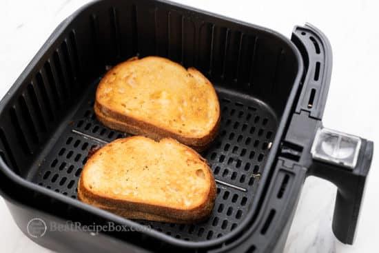 Grilled cheese sandwich in air fryer basket