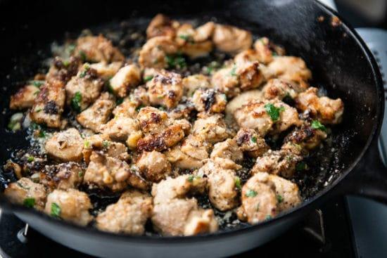 Finished garlic parmesan chicken bites in pan