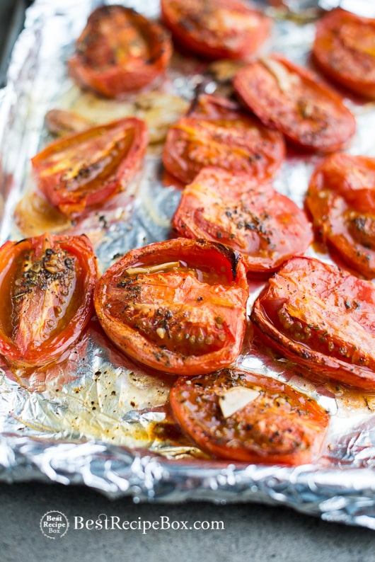 Garlic Roasted Tomates recipe is the Best Recipe with fresh tomatoes on a cooking sheet pan