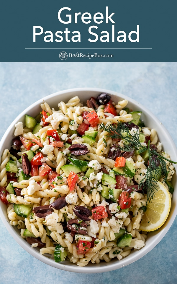 Bowl of greek pasta salad with a slice of lemon as garnish by bestrecipebox.com