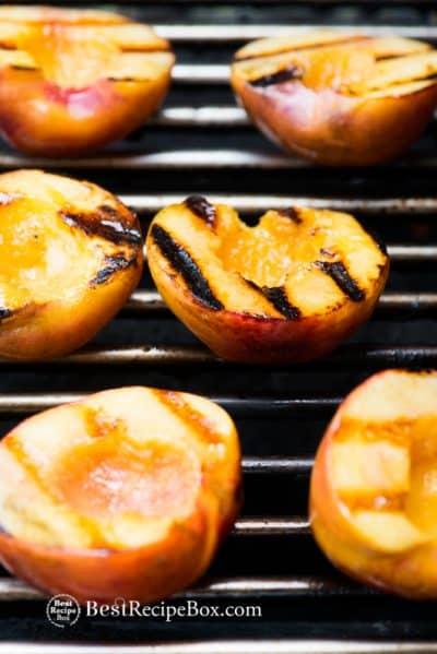 Grilled Peaches a la mode ice cream. Best Summer Peach Dessert Recipe on a grill