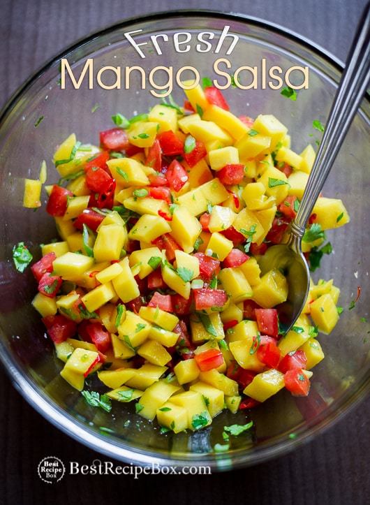 Mango Salsa Recipe in a glass bowl with spoon