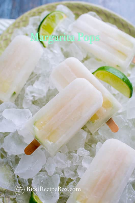 Boozy Margarita Popsicles Recipe Cocktail Pops on a plate with ice and limes