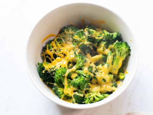 Microwaved broccoli with cheese melted on top