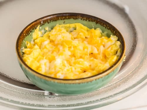 Cheese melted on top of scrambled eggs in microwave