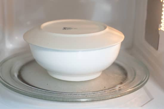 Bowl covered with a lid in microwave