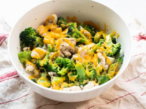 Cheese melted on top of chicken and broccoli