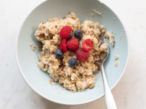 Oatmeal topped with berries and brown sugar