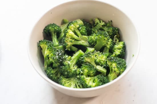 Finished microwaved steamed broccoli in a bowl