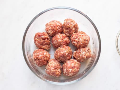 Meatballs in a single layer in microwave safe bowl