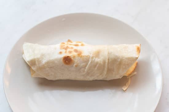 Filled tortilla rolled into a burrito