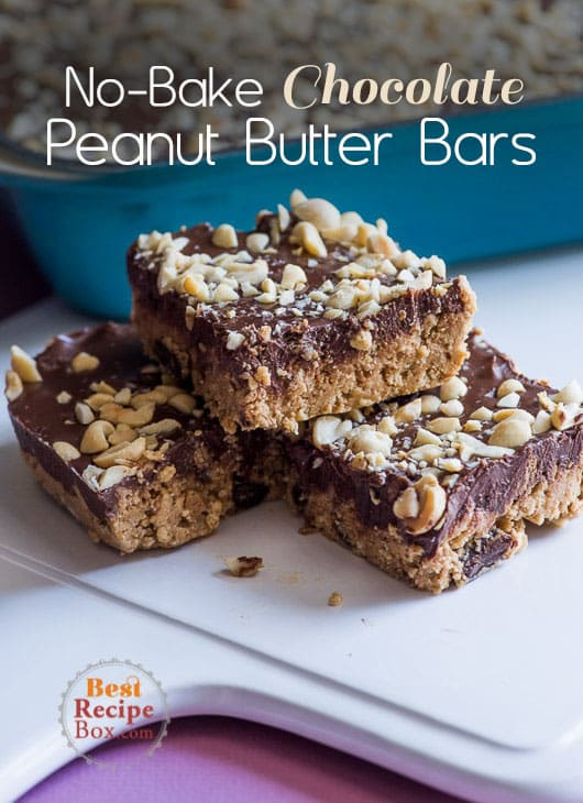 Amazing No-Bake Dark Chocolate Peanut Butter Bars with a touch to sea salt to make it perfect on wood cutting board