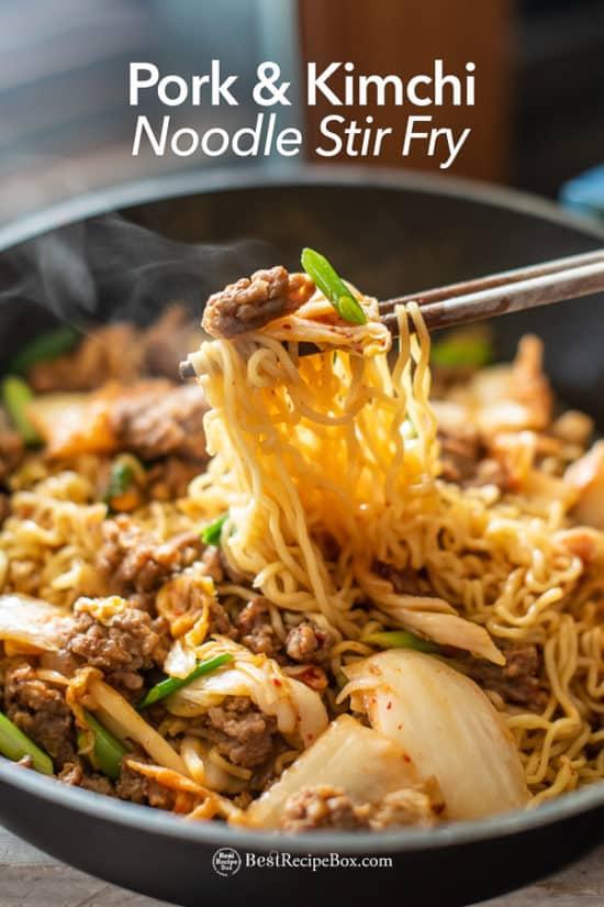 Korean Pork and Kimchi Stir Fried Noodles Recipe : Ramen Hack in cooking pot with chopsticks