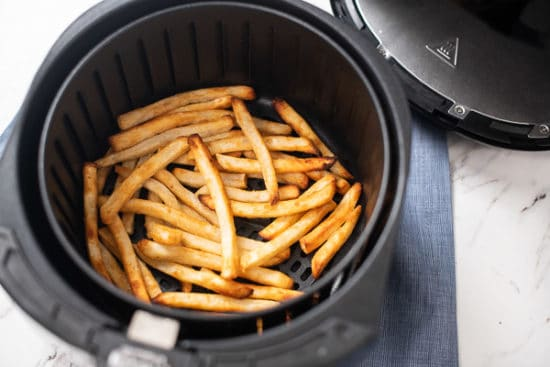 air fryer frozen fries crisped in basket
