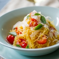 Baked Spaghetti Squash with Tomatoes and Parmesan Cheese thumbnail
