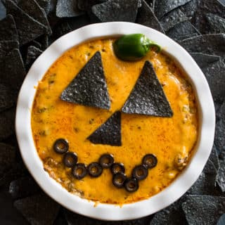 Jack-O-Lantern Cheesy Beef Taco Dip Recipe for Halloween! | @bestrecipebox
