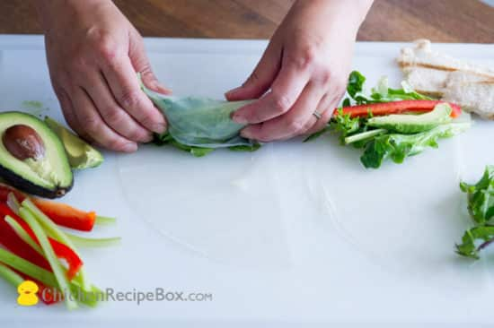 rice paper starting to wrap over ingredients