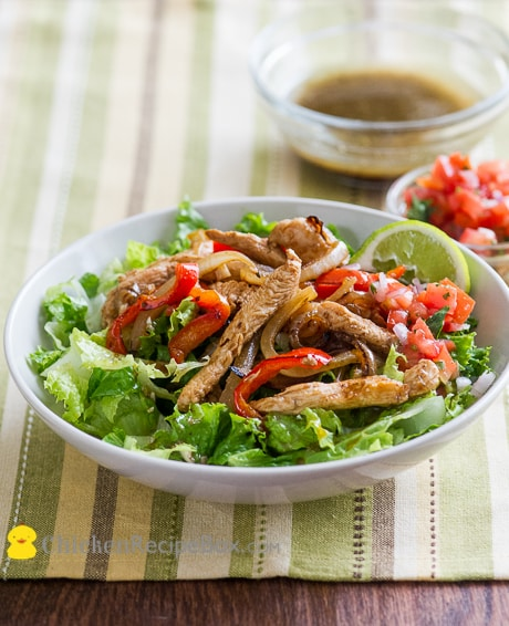 Healthy Chicken Fajitas Salad Recipe with Cumin Lime Dressing from ChickenRecipeBox.com
