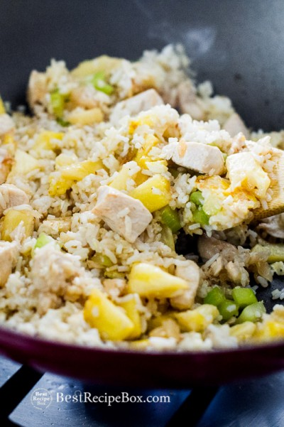 Chicken Pineapple Fried Rice Recipe in a bowl with chopsticks