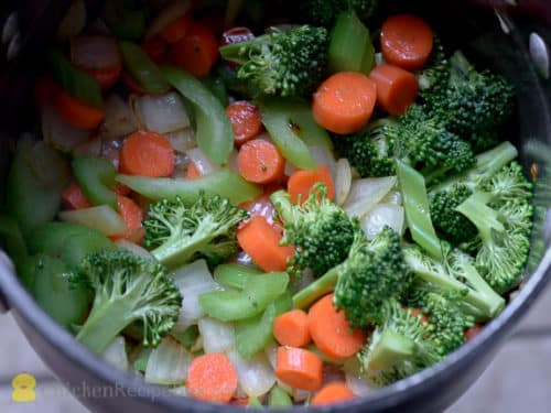 chicken and vegetables in a stock pot
