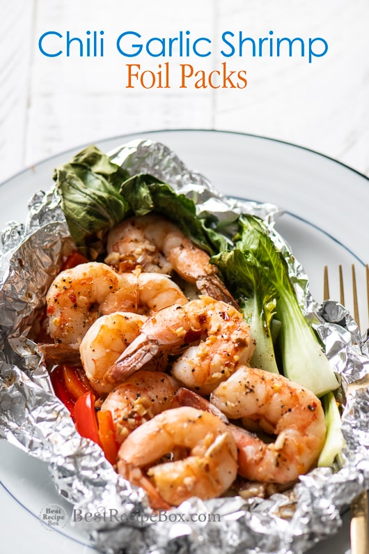 Chili Garlic Shrimp Foil Packs Dinners Healthy Seafood Foil Pack from on a plate