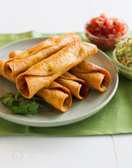 Easy Crispy Chicken Taquitos recipe or Rolled Chicken Tacos on a plate