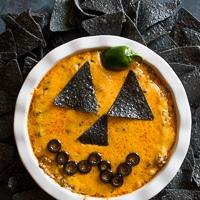 Jack-o-Lantern Cheesy Beef Taco Dip