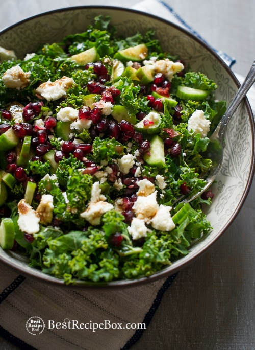 Healthy Kale Salad Recipe with Pomegranates, Feta Cheese and Cucumbers on BestRecipeBox.com