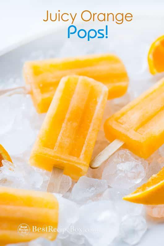 Juicy Orange Popsicles Recipe on a bowl of ice