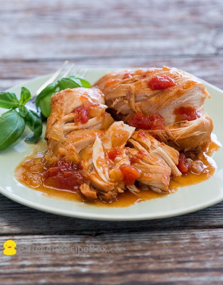 Slow Cooker Chicken with Sriracha and Tomato- super juicy and tender! Recipe from ChickenRecipeBox.com