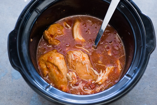 Slow Cooker Sriracha and Tomato Chicken-- Easy and super juicy chicken recipe for rice, pasta or tacos. From ChickenRecipeBox.