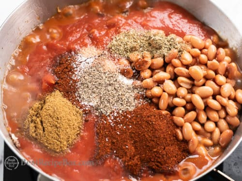 Add tomato sauce and spices with beans